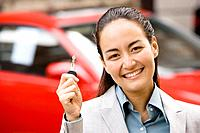 Asian woman holding car key