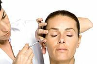 Woman receiving Botox injection, eyes closed (thumbnail)