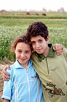 Egyptian Village boy & girl at wheat harvest time in Monofeya Governorate is one of the Egyptian Governorates