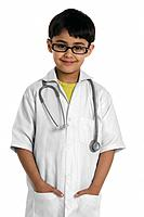 A boy wearing a doctor´s coat