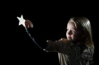 A girl holding a star