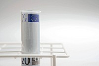 Euro currency in a test tube