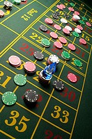 Roulette table and gambling chips
