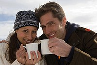 A couple having a hot drink