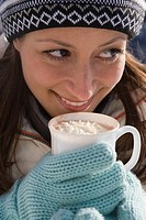 Portrait of a woman holding a cup of hot chocolate