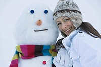 Portrait of a woman and a snowman