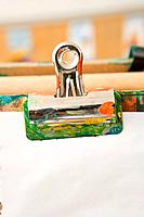 Bulldog clip holding paper on easel