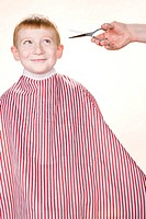 A boy about to have his hair cut