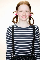 Portrait of a girl with pigtails
