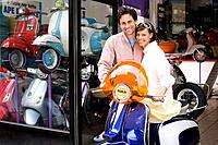 Couple purchasing scooter, smiling, portrait