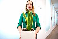 Businesswoman with potted plant, portrait
