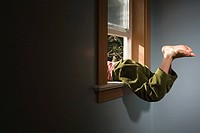 Boy climbing out of window (thumbnail)
