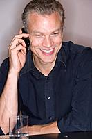 Man on mobile phone, smiling