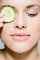 Woman with cucumber over her eye (thumbnail)