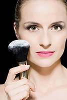 Woman with face powder