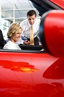 Woman viewing convertible in showroom