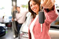 Woman holding up new car keys