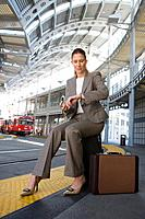 Businesswoman waiting with luggage at airport