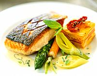 Grilled salmon steak with vegetables and carrot flan