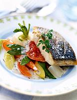 grilled piece of bass with granulated salt and young vegetables