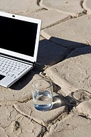 Laptop with glass of water, elevated view