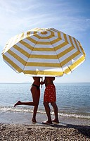 Couple on the beach under umbrella