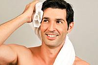 Young male adult towel drying