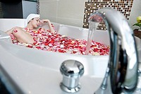 Young woman in bathtub, elevated view