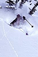 A man telemark skiing in the backcountry near Brighton UT