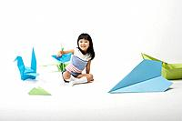 Young Korean Girl Playing with Origami