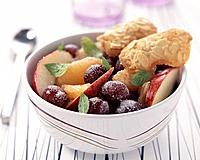 Grapefruit,grape and apple fruit salad with almond tuile biscuits