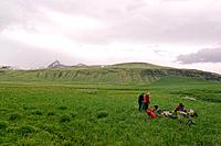 Friends camping on Umnak Island in the Aleutian Islands Alaska