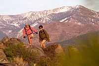 A man and woman hiking in the fall with the snowy Sierra mountains in the background