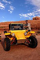 Tourist riding Tomcars little Israelian buggy jeeps Moab Utah USA MR