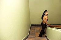Young latina woman in sexy trouser suit