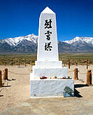 Memorial at Manzanar Cemetery and Mount Williamson. Manzanar National Historic Site. Sierra Nevada Mount Range, California. USA
