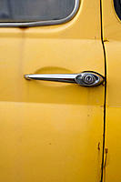 Old Fiat, detail of door. Taormina. Sicily, Italy