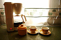 Coffee machine and cups in kitchen
