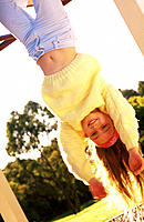 Girl hanging upside down, 8 yrs