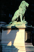 Lions at the entrance to Louvre Museum. Paris. France