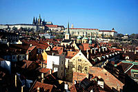 Overview on the city roofs, Hradcany hill at back. Prague. Czech Republic
