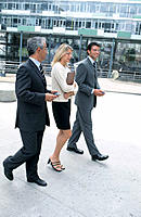 Three businesspeople walking outside