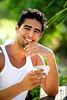 Man, young, coffee_cup, laughing, watching, camera, garden,