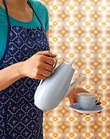 Woman with coffee pot and cup
