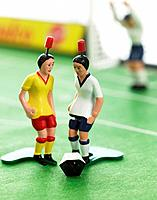 Three soccer figurines