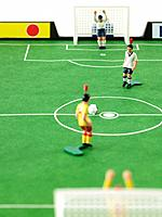 Soccer figurines on pitch
