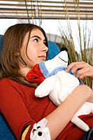Girl with stuffed animal (thumbnail)