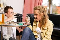 Teenage boy and girl smoking and drinking (thumbnail)