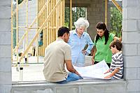 Family Looking at Plans for Dream Home
