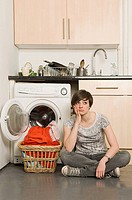 Sullen young woman and laundry (thumbnail)